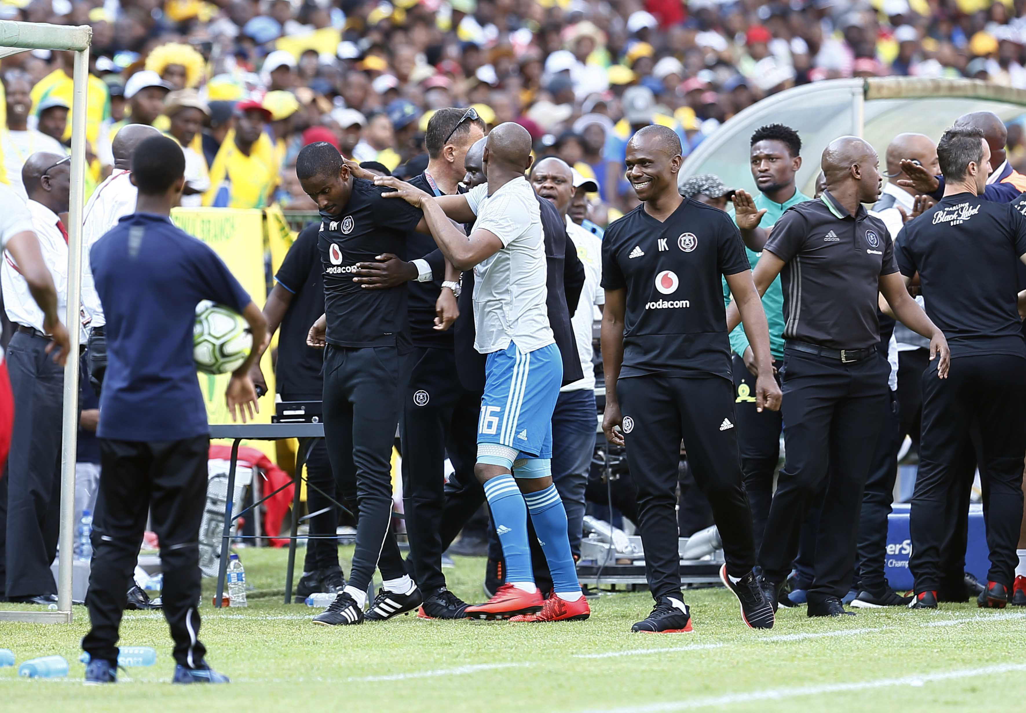 10 November 2018: Pirates assistant coach Rhulani Mokwena is led away after the confrontation with a Sundowns fan during the Absa Premiership match between Mamelodi Sundowns and Orlando Pirates at Loftus Versfeld. (Photo by Phill Magakoe/Gallo Images)