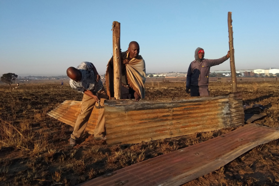 12 May 2018: Occupiers building a shack on Saturday morning. (Photograph by: Dennis Webster)