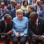 30 October 2018: (From left) Rwanda's President Paul Kagame, Germany's Chancellor Angela Merkel and South Africa's President Cyril Ramaphosa at the G20 Investment Summit in Berlin, Germany. (Photograph by Christian Marquardt - Pool/Getty Images)