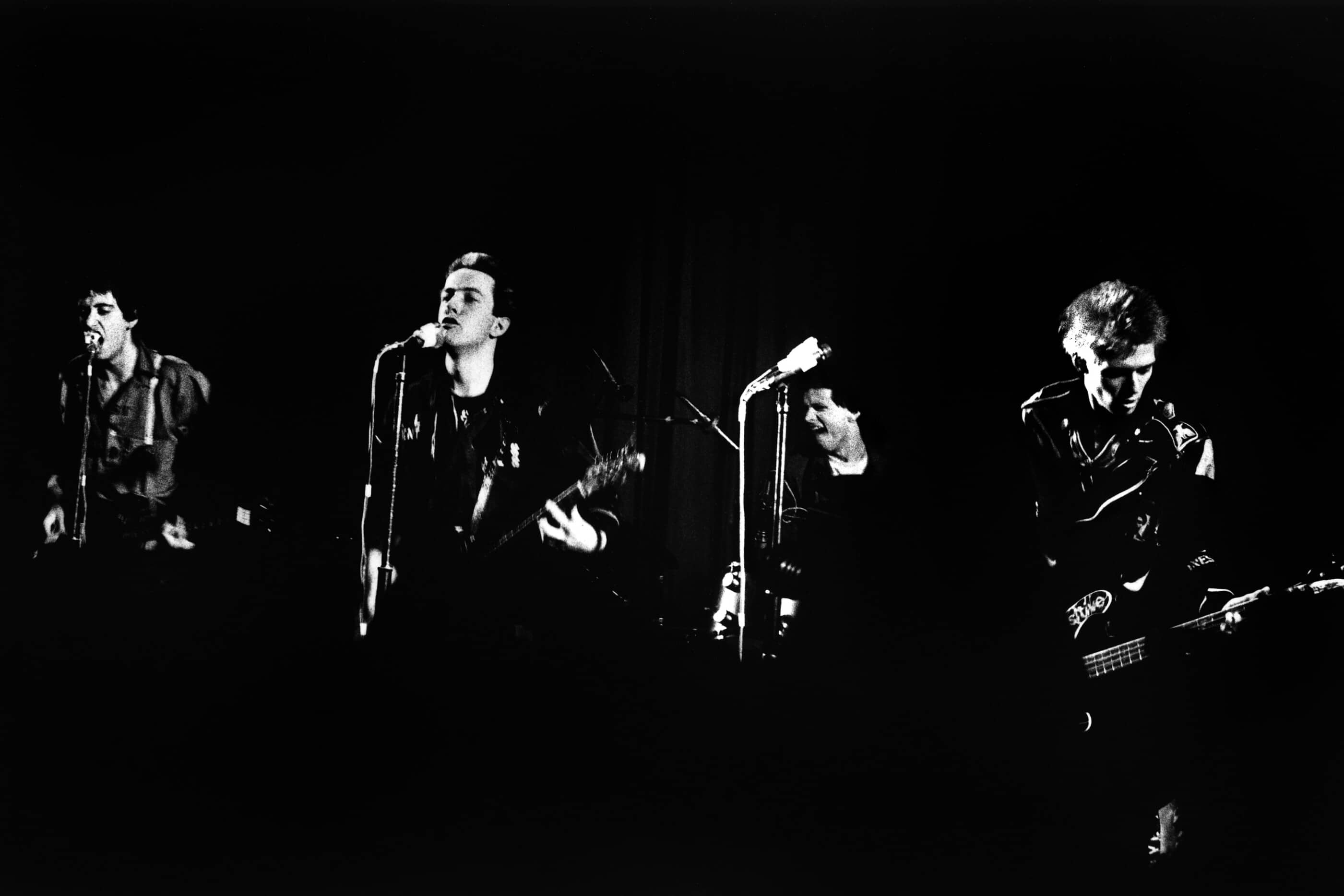 11 March 1977: British punk group The Clash performing at the Coliseum Cinema in Harlesden, London, UK. (Left to right) Mick Jones, Joe Strummer, Terry Chimes and Paul Simonon. (Photograph by Julian Yewdall/Getty Images)