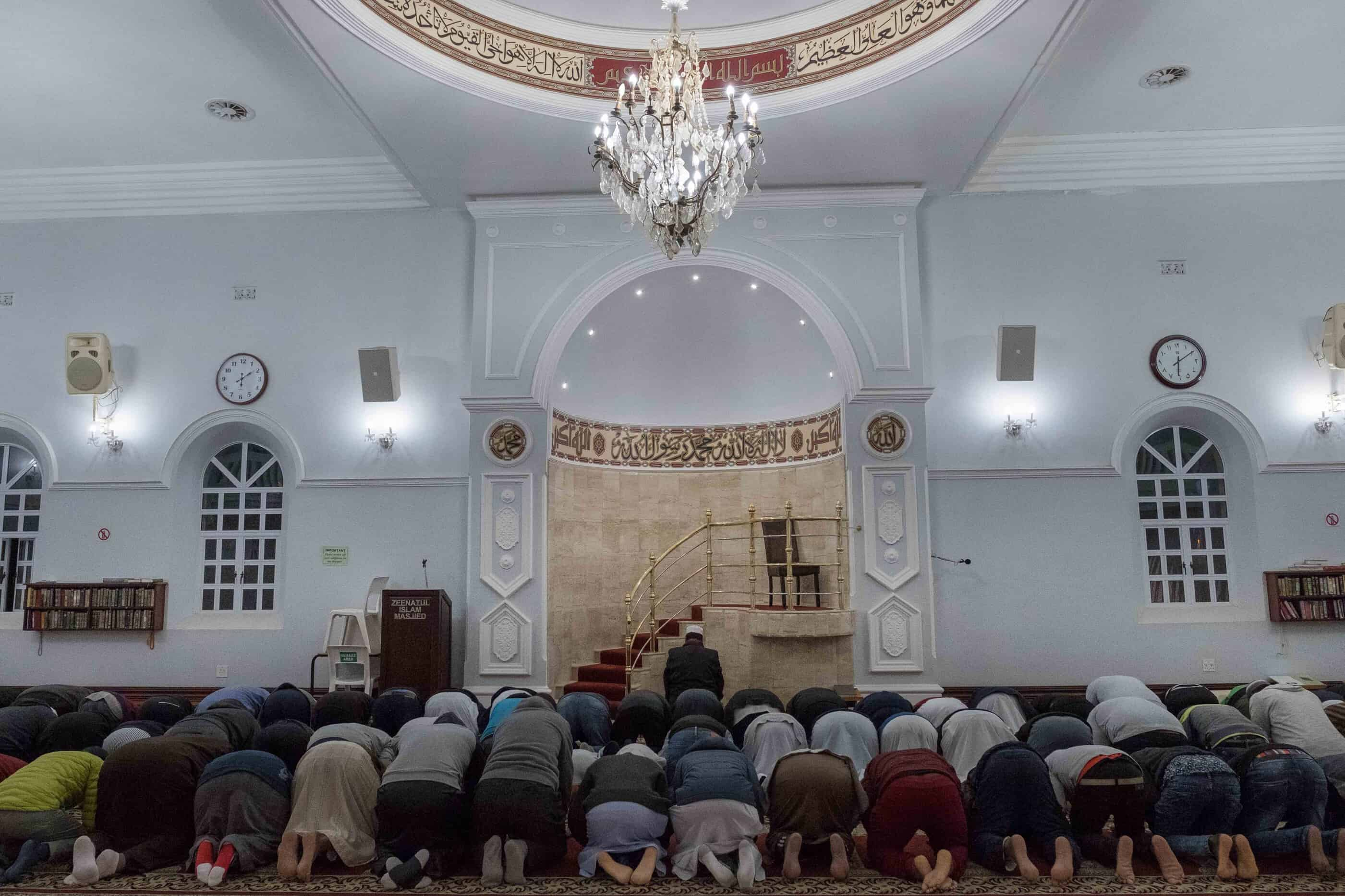 19 May 2019: Sheikh Moeghammad Moerat leads men in prayer at the Zeenatul Islam mosque in District Six, Cape Town.