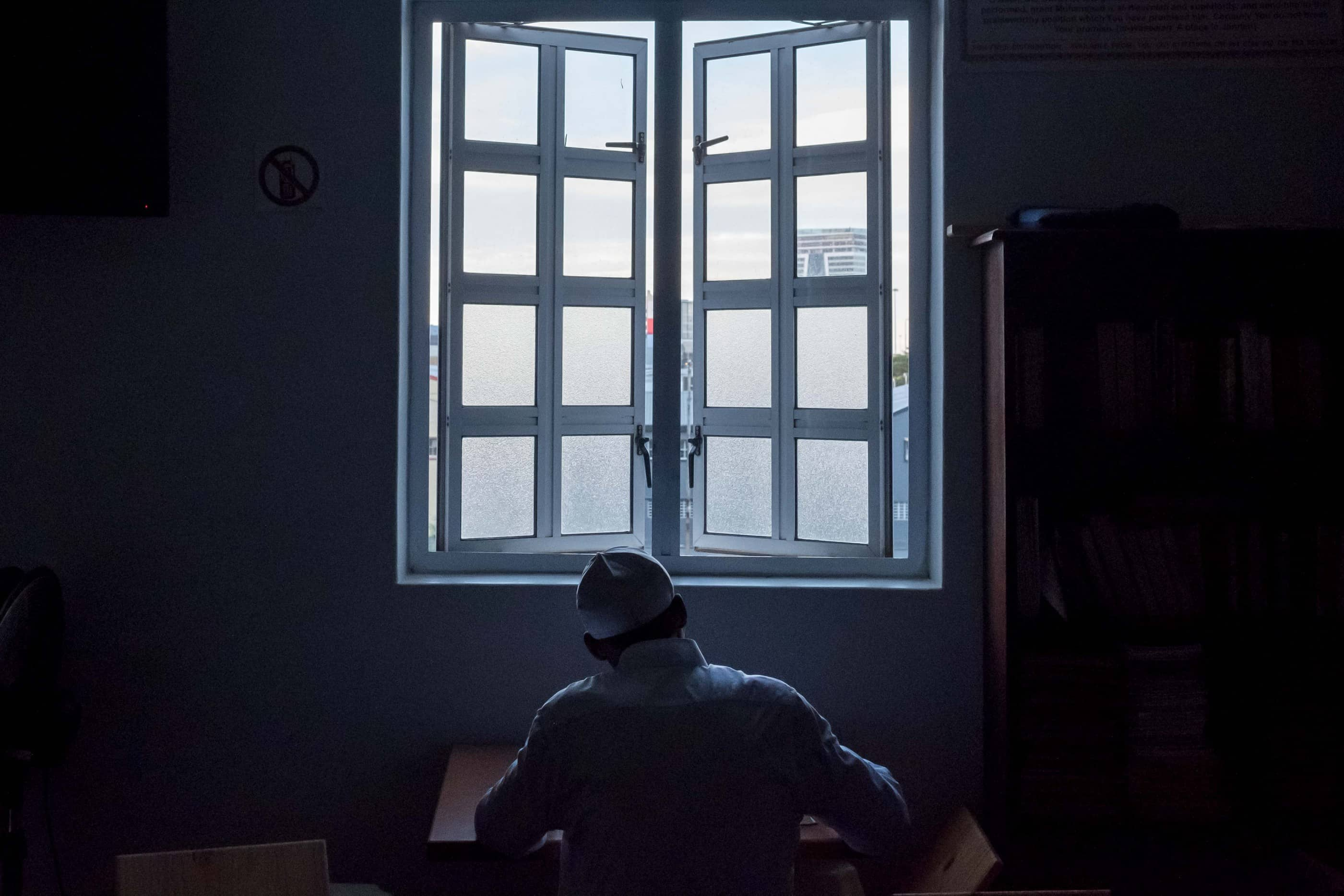 18 May 2019: A man reading the Quran at the mosque.