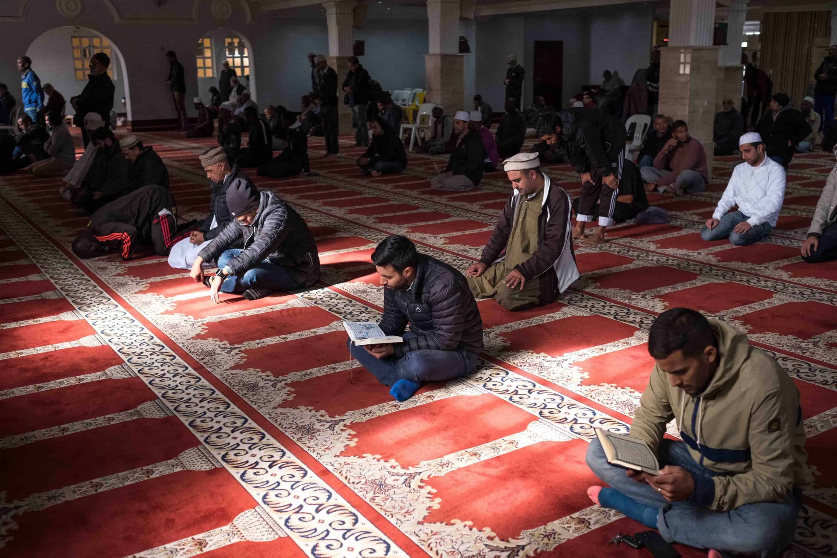 20 May 2019: Men reading the Quran and praying at the historic mosque in District Six.
