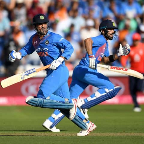 6 July 2018: MS Dhoni (left) and Virat Kohli of India run between the wickets during a T20 match against England at Swalec Stadium in Cardiff, Wales. (Photograph by Gareth Copley/Getty Images)