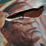 21 March 2008: A torn poster of former Zimbabwean president Robert Mugabe, who despite originally wanting to revert Africa 'to what it was before the imperialists divided it' didn't demonstrate the true meaning of Ubuntu during his long tenure. (Photograph by John Moore/Getty Images)