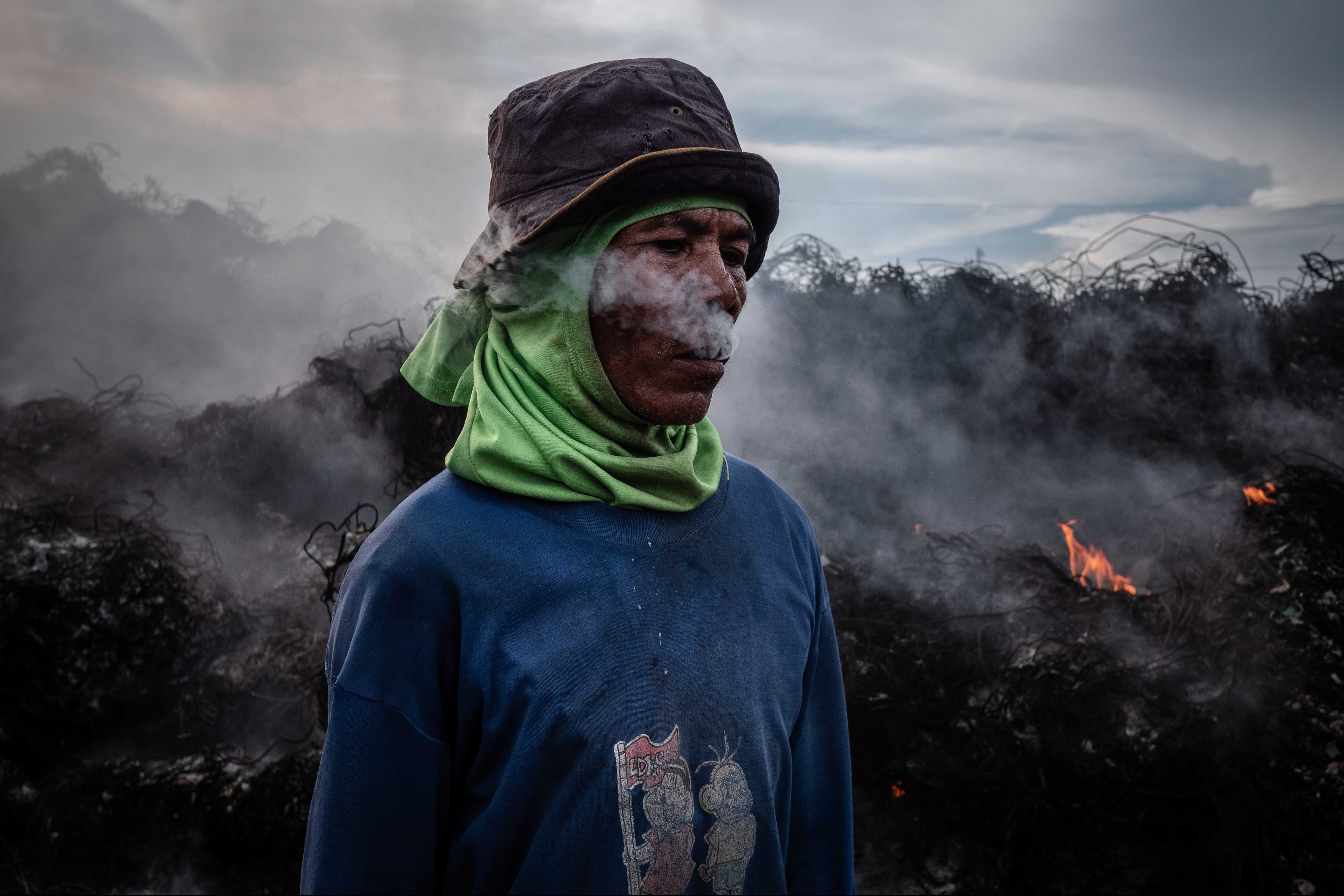 4 December 2018: Burning plastic that cannot be recycled at import dumps such as this one in Mojokerto, East Java, Indonesia, releases millions of tonnes of greenhouse gases into the atmosphere every year. (Photograph by Ulet Ifansasti/Getty Images)