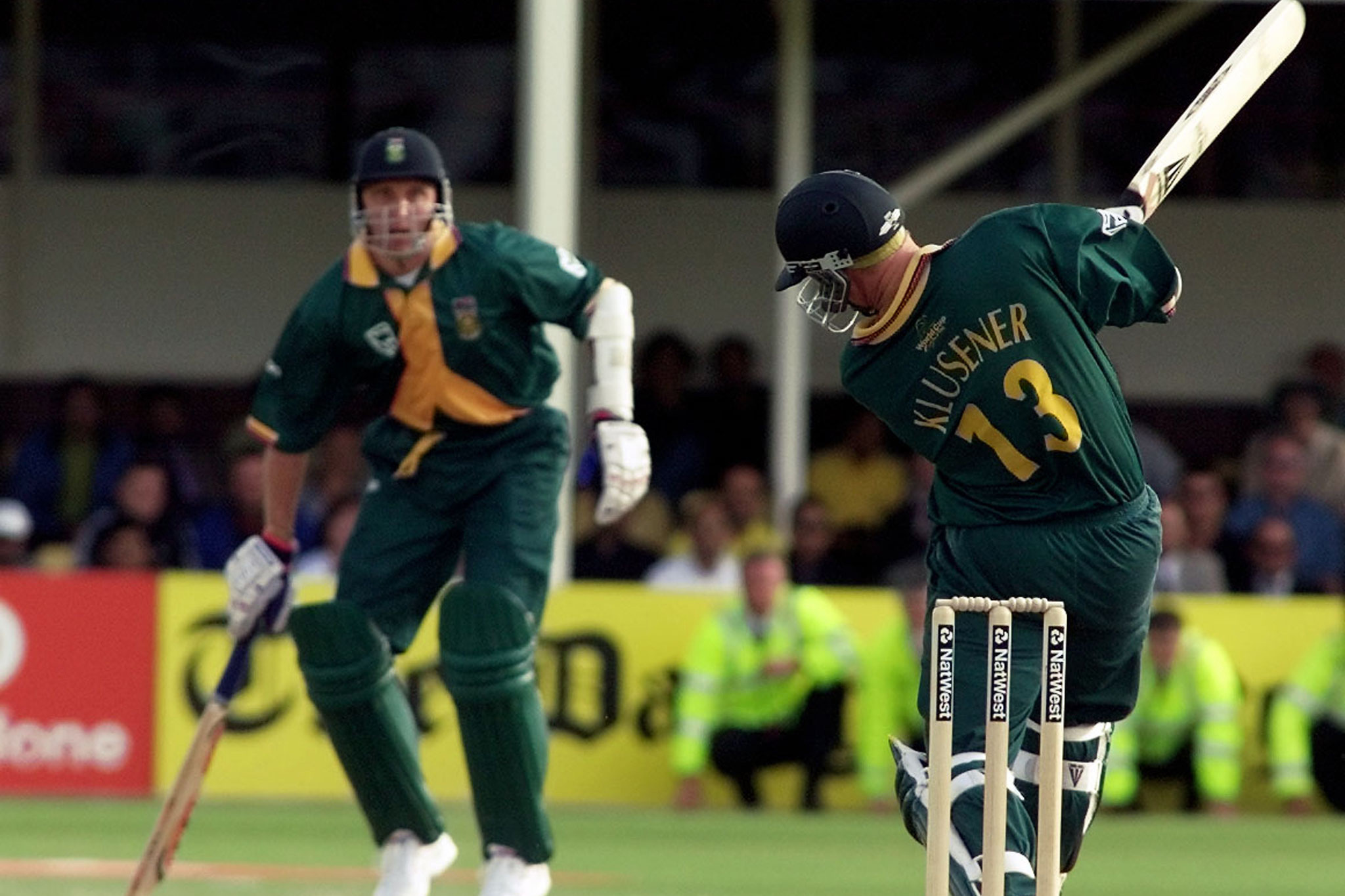 17 June1999: South African batsman Lance Klusener smashes a ball through the onside during the Proteas' semi-final run chase against Australia at Edgbaston in the Cricket World Cup. Teammate Allan Donald, looking on, was run out later with the Proteas one run short of victory. (Photograph by Reuters)