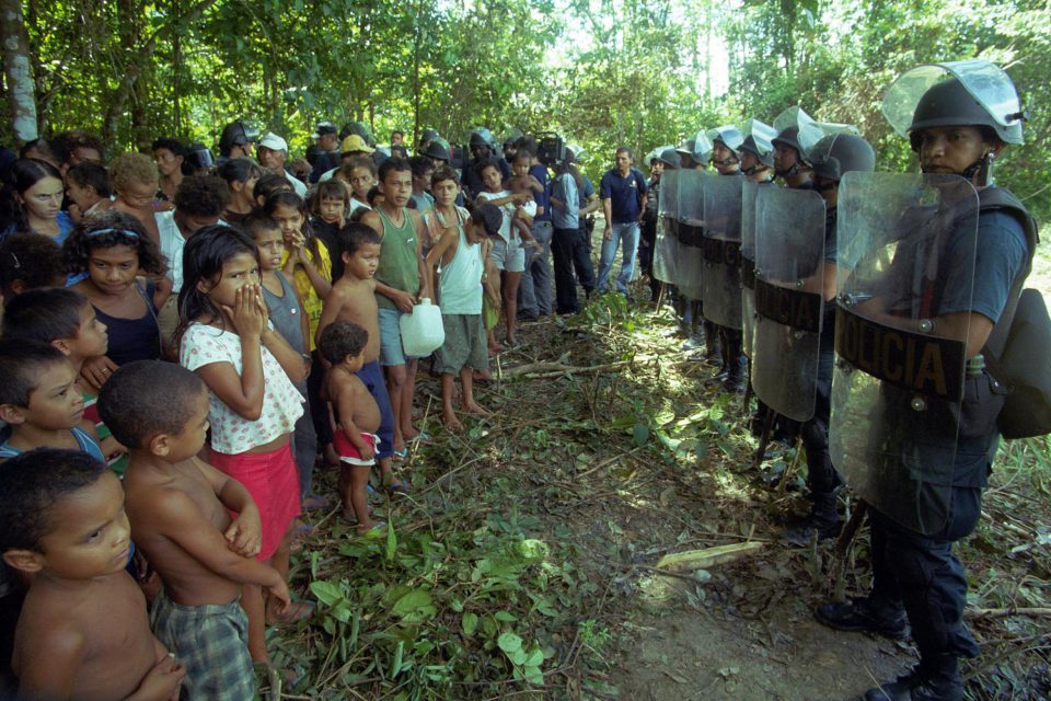 "17 April 2001: Children of members of Brazil's Landless Workers Movement (MST) occupy a ranch at Belém-Brasilia Highway in Pará State, northern Brazil. The occupation was part of ""Red April"", the anniversary of a massacre in which 19 MST members were killed by the police in Eldorado dos Carajas. (Photograph by Paulo Amorim)"