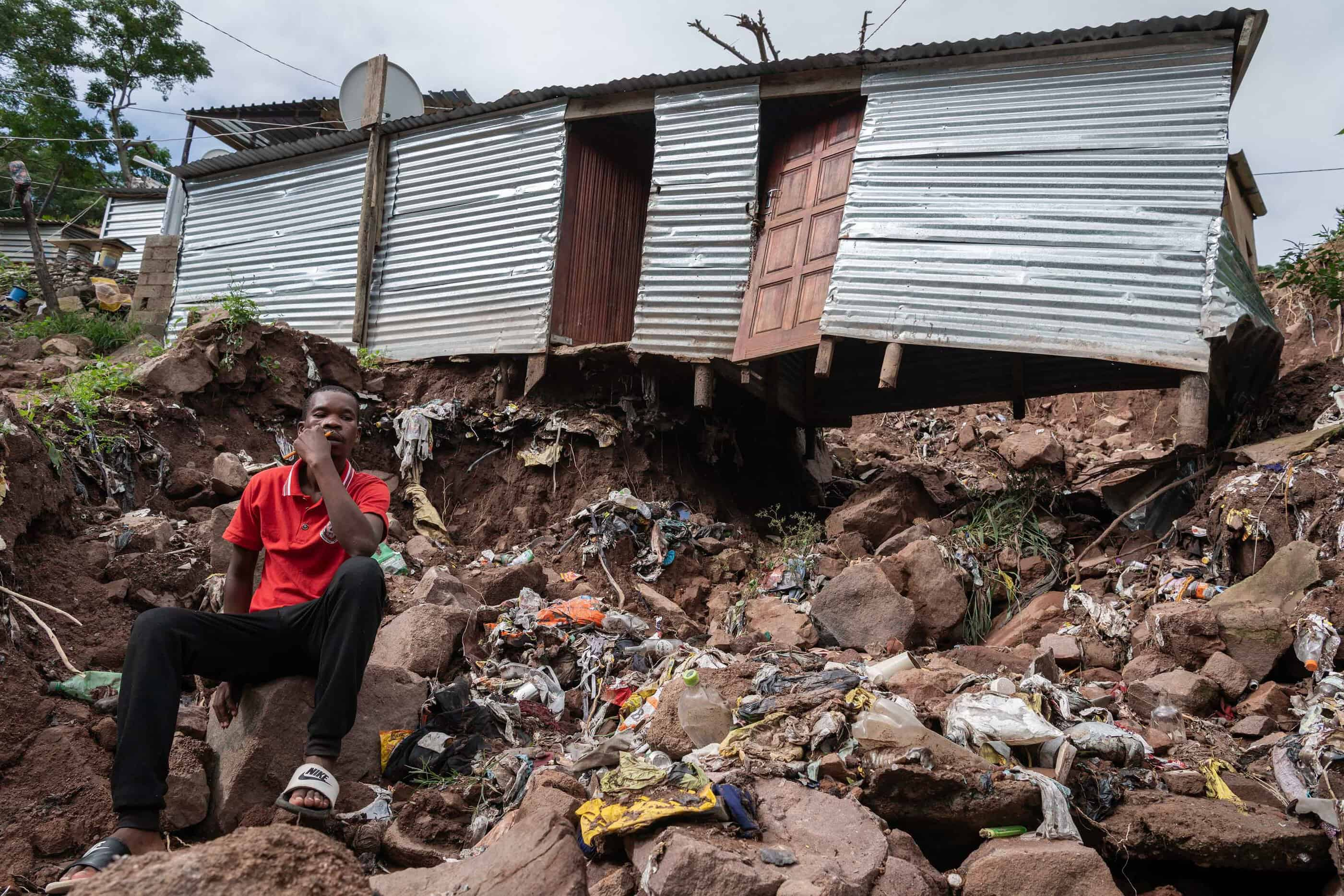 25 April 2019: Goodman Mpendulo Zulu outside his home in the Khokhoba informal settlement in Chatsworth which was badly damaged during the recent floods after the ground beneath his home was swept into the river below.