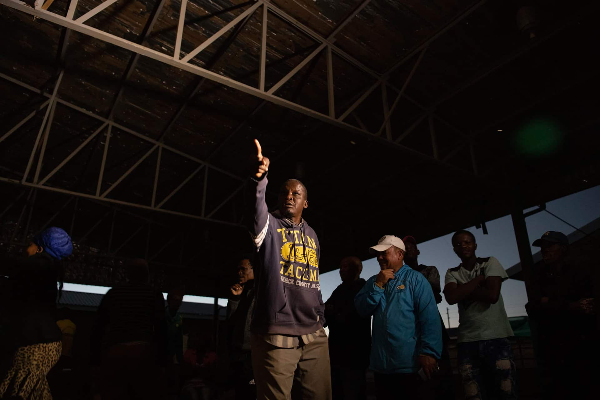 25 April 2019: Local resident Rawe Kakawu reacts in the moment to a statement from the ANC representative in the debate being aired live on X-K Fm.