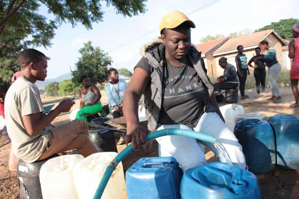 8 May 2019: Instead of voting in the 2019 elections, Magau Phathutshedzo, 24, collects water from a local tap in Vuwani outside Thohoyandou, Limpopo.