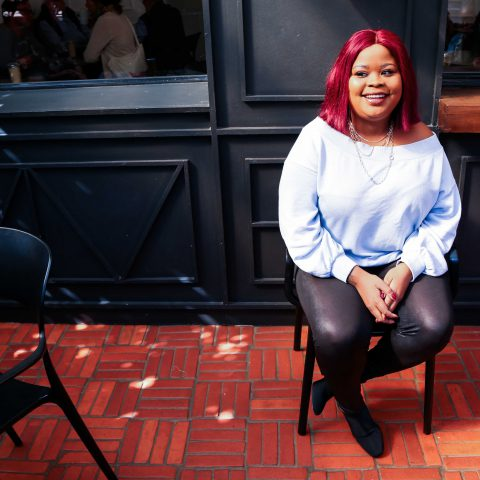 29 May 2019: South African satirist and comedian Lesego Tlhabi, also known as Coconut Kelz, during her Interview with 'New Frame' at the Whippet Cafe in Linden, Johannesburg. (Photograph by Nina Bekink)