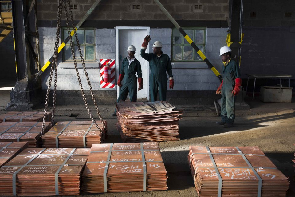 6 July 2016: Workers moving sheets of copper in a warehouse in Mufulira, Zambia. Anglo-Swiss trading and mining firm Glencore owns 73.1% of Zambian-registered Mopani Copper Mines. (Photograph by Per-Anders Pettersson/Getty Images)