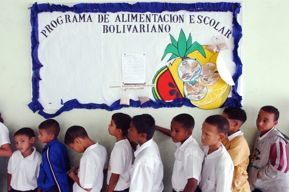 "24 April 2003: Students lined up for lunch at the Florencio Jimenez school in Caracas, Venezuela. The school was one of the new ""Bolivarian"" institutions that formed part of late President Hugo Chavez's education reforms."