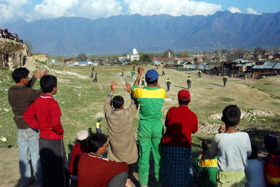 12 March 2004: Kashmiris playing cricket in Pakistani kit in Srinagar, the summer capital of the Indian-held state, on the evening of the much-anticipated first one-day international game of India's tour of Pakistan. (Photograph by Ami Vitale/Getty Images)