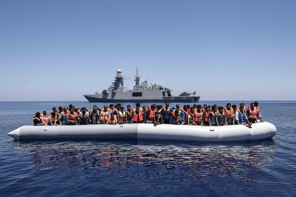 24 June 2017: The crew of Carlo Margottini rescue 121 migrants in an inflatable dinghy 20 miles off the coast of Libya as part of the Italian Navy's rescue operations in the Mediterranean Sea. (Photograph by Fabrizio Villa/Getty Images)