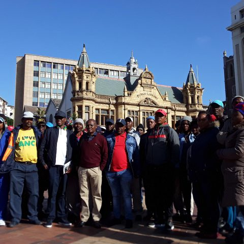 Undated: Nelson Mandela Bay union coordinator Siphiwo Ndunyana (maroon jersey), provincial chairperson Mlamli Sidzumo (black cap and jacket) and provincial deputy chair Bongani Cola (red shirt and denim jacket). (Photograph by Anna Majavu)
