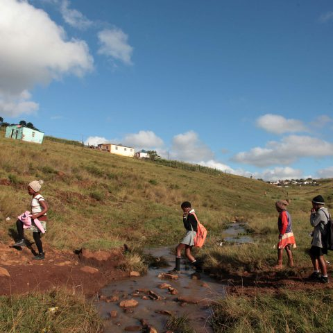 24 April 2019: Pupils from the Camagu primary school have to cross a stream that floods during heavy rain to get to school. They are forced to walk the long way around or stay at home when the water rises.