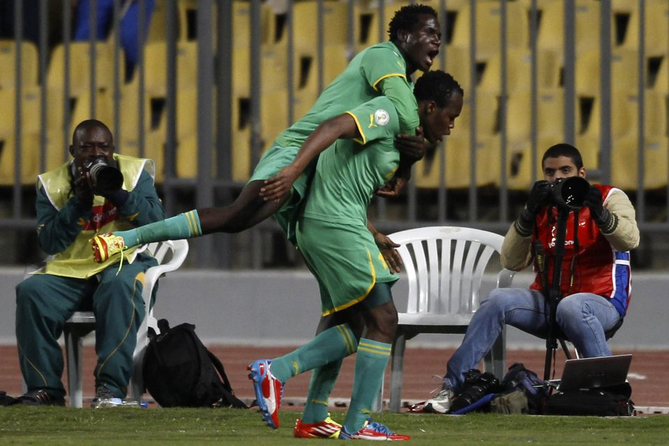 26 March 2013: Zimbabwe's Roderick Mutuma (top) celebrates with teammate Knowledge Musona after the latter scored against Egypt during their 2014 World Cup qualifier at the Borg El Arab Stadium west of Alexandria in Egypt. (Photograph by Reuters/Amr Abdallah Dalsh)