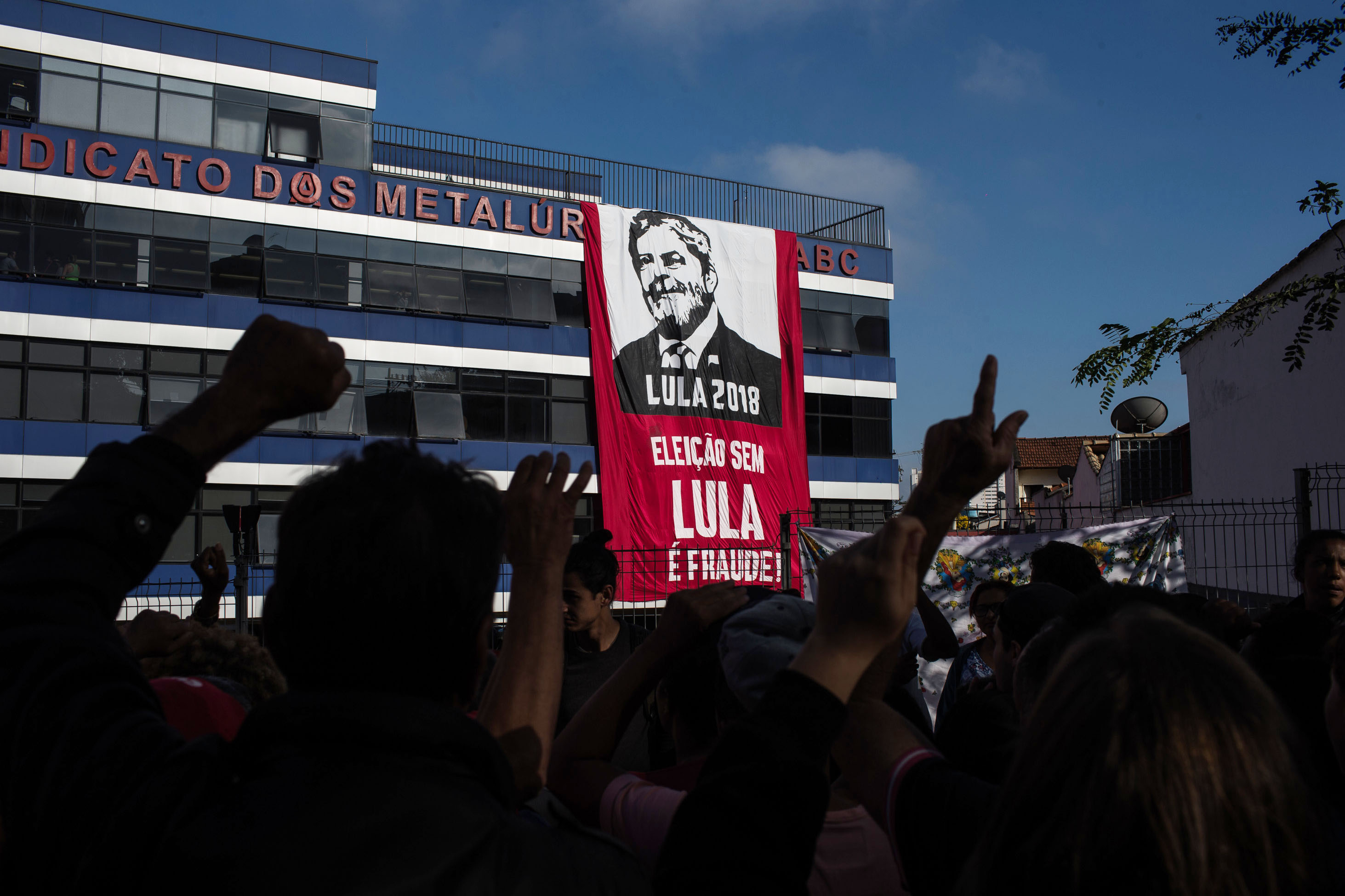 6 April 2018: Supporters of former Brazilian President Luiz Inacio Lula da Silva gather in front of the headquarters of the Metalworkers' Union while awaiting Lula's speech in Sao Bernardo do Campo, Brazil. (Photograph by Victor Moriyama/Getty Images)