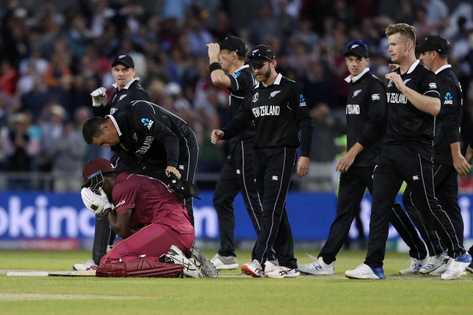 22 June 2019: New Zealand players console West Indies allrounder Carlos Brathwaite after he lost his wicket and the match against them at Old Trafford during the ICC Cricket World Cup. (Photograph by Action Images via Reuters/Lee Smith)