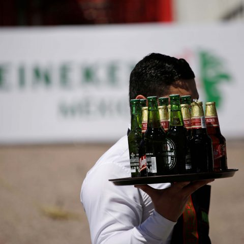 27 February 2018: A waiter carries bottles of beer during the official opening of the new Heineken brewery in Meoqui in Chihuahua state, Mexico. (Photograph by Reuters/Jose Luis Gonzalez)