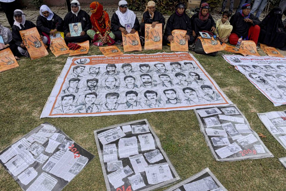 30 August 2017: Relatives hold pictures of missing persons during a protest on International Day of the Disappeared to draw attention to alleged gross human rights violations by Indian troops in Kashmir. (Photograph by Yawar Nazir/Getty Images)