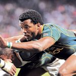 Undated: Mpho Mbiyozo during a sevens rugby match in a photo from sports photographer Wessel Oosthuizen's Portrait of Rugby, a collector's item coffee-table book published in 2008 and re-edited for a second print run in 2016. (Photograph by Wessel Oosthuizen/Gallo Images)
