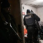12 July 2019: South African Police Service officers conduct searches in homes across Phlippi East in the early hours of the morning.