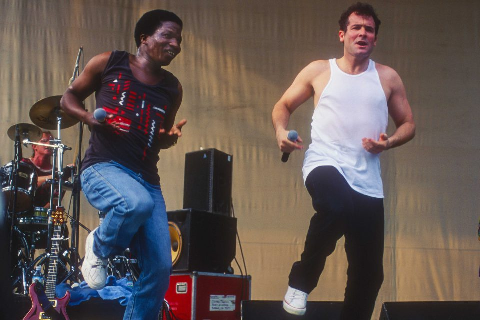 14 July 1996: Sipho Mchunu (left) and Johnny Clegg perform with their band Juluka at Central Park SummerStage, New York. (Photograph by Jack Vartoogian/Getty Images)