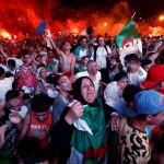 14 July 2019: Football fans in Algiers after Algeria won their Africa Cup of Nations semifinal against Nigeria. (Photograph by Reuters/Ramzi Boudina)