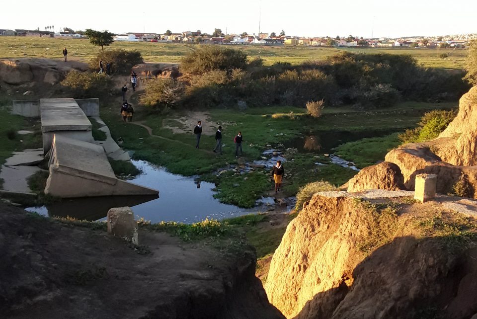22 July 2019: Schoolgoers crossing the dangerous ravine in Uitenhage on their way to school. (Photograph by Anna Majavu)
