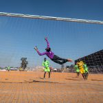 14 July 2019: A goalkeeper pulls off a spectacular save during the first semi-final between D10 and Lebashe at the annual Maimane Alfred Phiri games at the Rotary Grounds in Alexandra, Johannesburg.