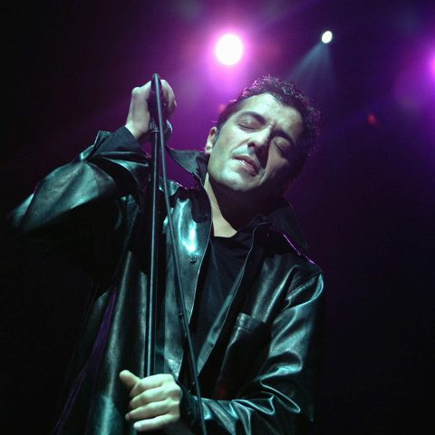 21 October 2002: Rachid Taha on stage at the Royal Festival Hall in London, United Kingdom. (Photograph by James Emmett/Redferns)