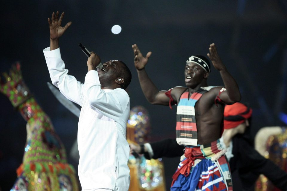 5 July 2009: Senegalese singer Youssou N'Dour performs during the opening ceremony of the second Pan African Cultural Festival (Panaf) of Algiers at the Mohamed-Boudiaf Olympic Complex. Algeria first hosted the Panaf in 1969. (Photograph by REUTERS/Louafi Larbi)