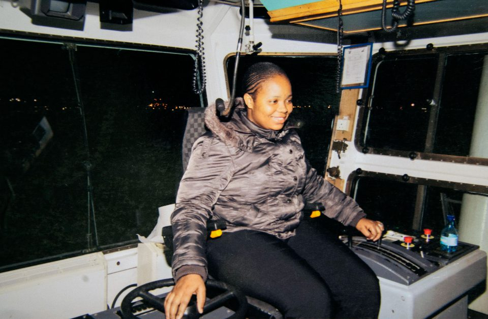 Undated: Transnet pilot boat trainee Thandeka Mzimela in action as a tug master in this photo from the family album. (Photograph courtesy of the Mzimela family)