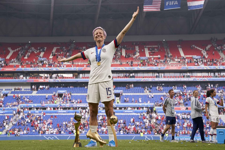 7 July 2019: Megan Rapinoe of the United States with the Fifa Women's World Cup trophy alongside her personal Golden Boot and Golden Ball silverware. The US beat Netherlands in the final at Stade de Lyon in Lyon, France. (Photograph by Quality Sport Images/Getty Images)