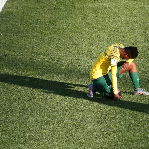 17 June 2019: South Africa's Mamello Makhabane kneels dejectedly after Banyana lost their World Cup group stage match against Germany at Stade de la Mosson in Montpellier, France. (Photograph by Reuters/Eric Gaillard)