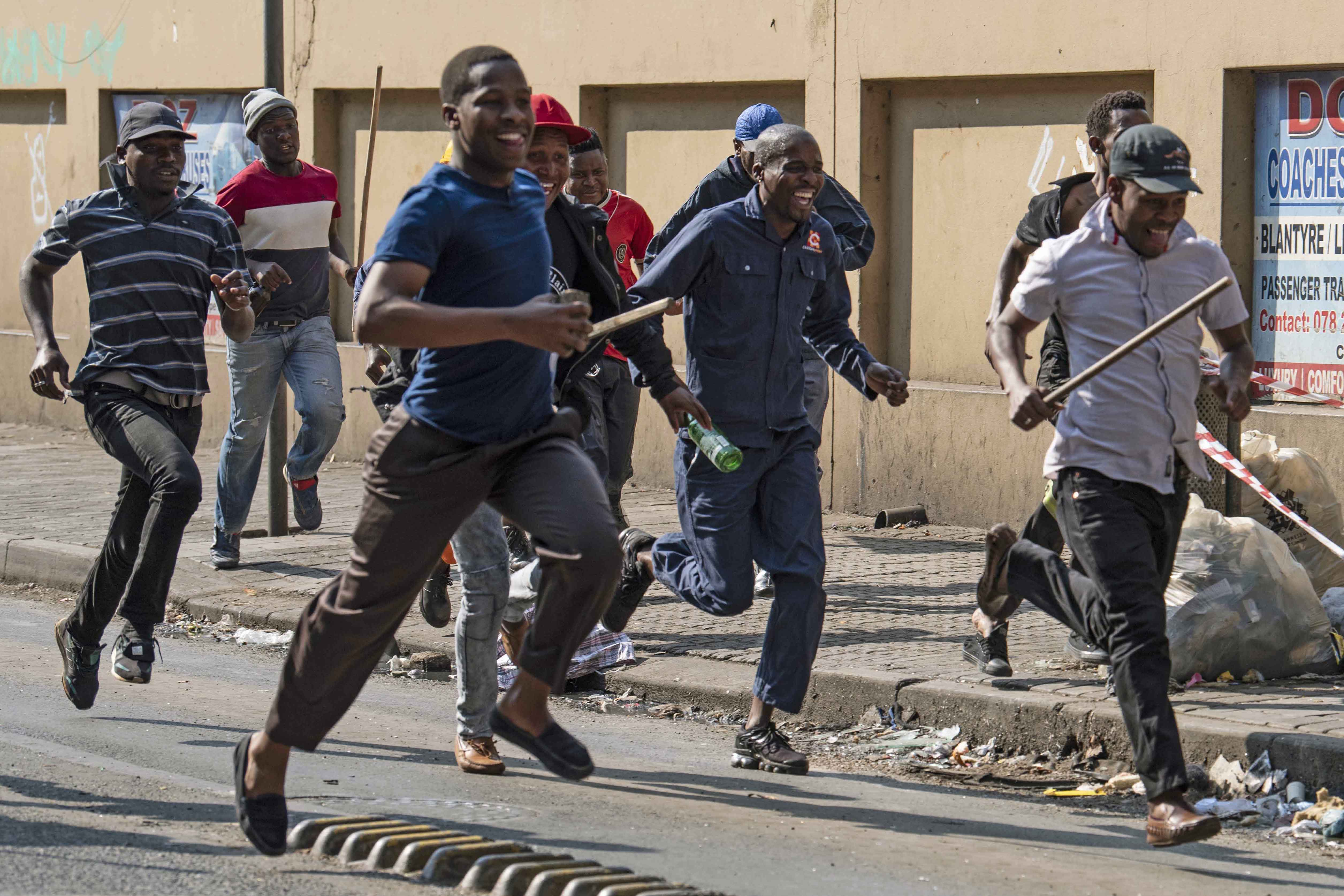 7 August 2019: Looters run through central Johannesburg after police opened fire with rubber bullets. A police operation targeting foreign-owned businesses in the Fashion District led to protesters looting stores in the central business district.