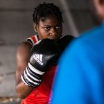 11 July 2019: Princess Oluwapelumi Adewale, a 17-year-old boxer in a training session with her coach at the National Stadium in Lagos, Nigeria.
