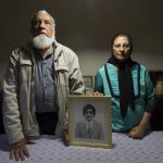 22 March 2018: Ismail Haffejee and Sarah Lall with a portrait of their brother, Hoosen Haffejee, who died in police custody in the cells at Brighton Beach Police Station in Durban, South Africa, in 1977. (Photograph by Rogan Ward/ Mail and Guardian)