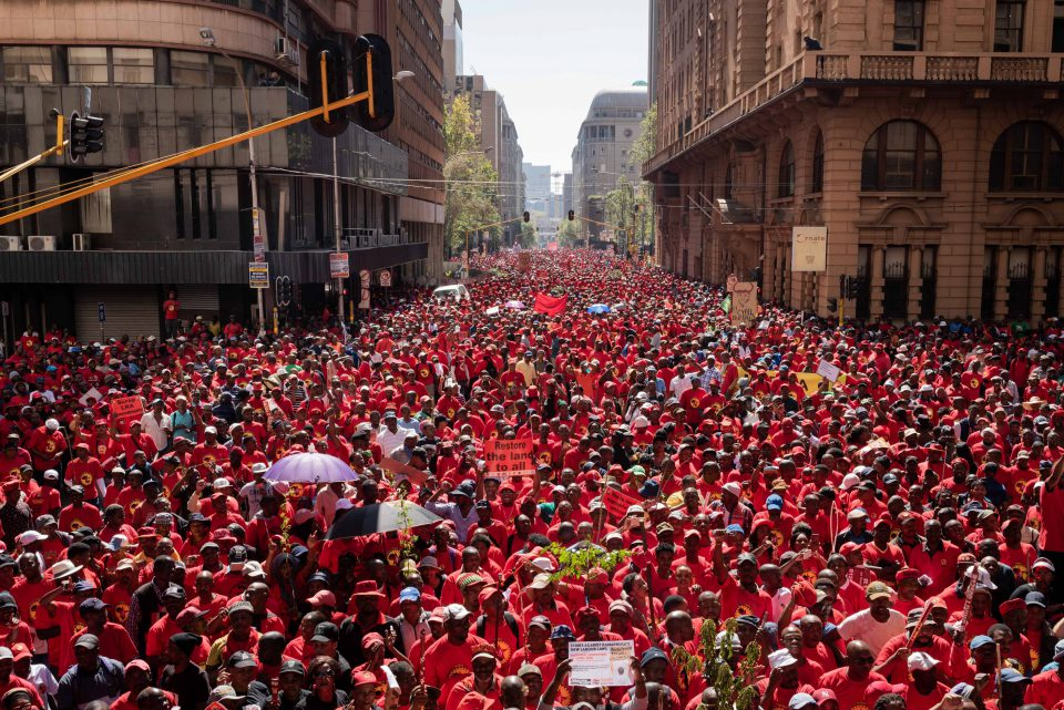 25 April 2018: Thousands of protesters marching down Simmonds Street in central Johannesburg from Gauteng's provincial government offices. The march was a part of Saftu's national shutdown and protests against the proposed minimum wage of R20 an hour. (Photograph by Daylin Paul)