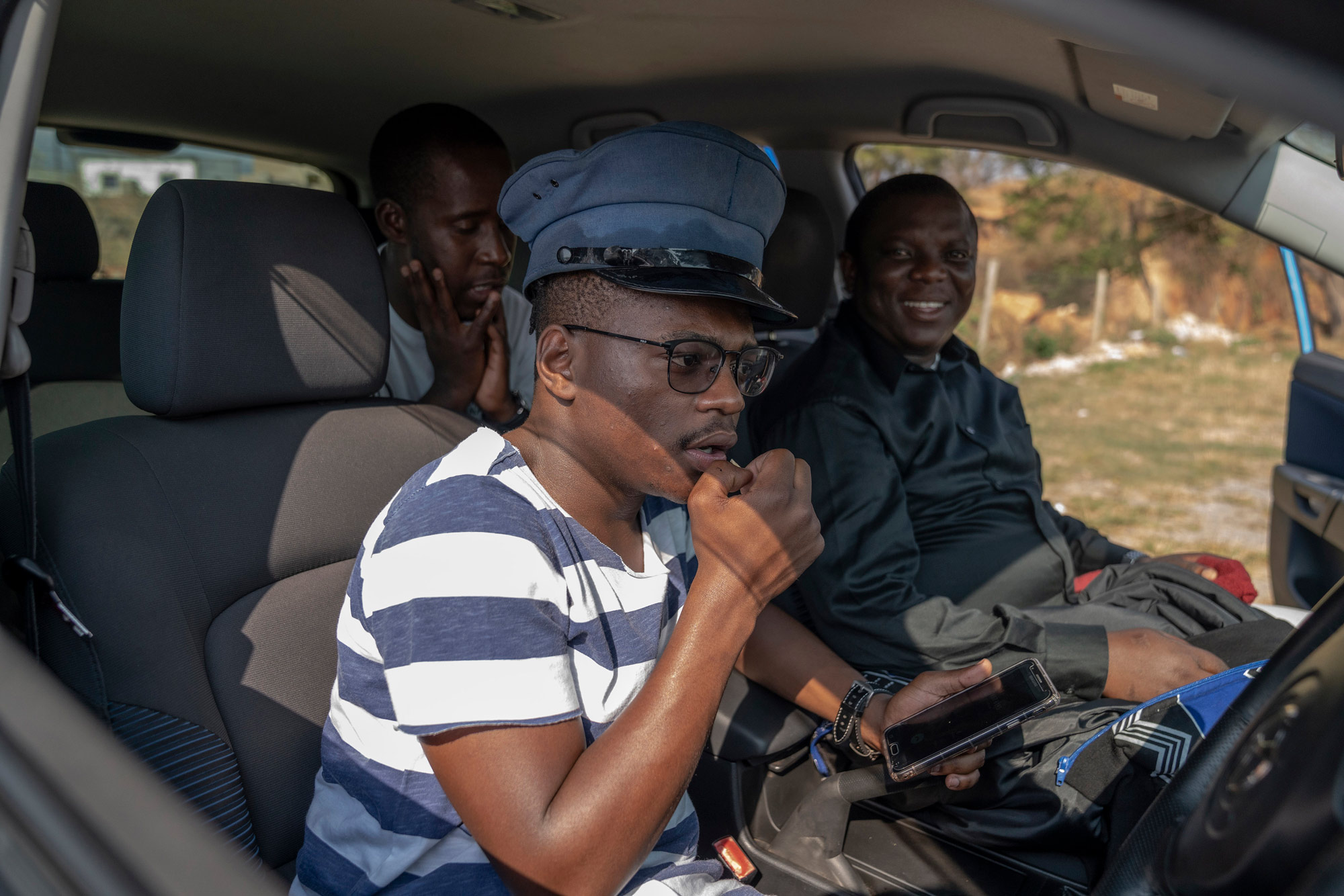 7 August 2019: Comedians S'lwane, Smallz and Gedlembane recording a video in their car with an iPhone. They use the camera selfie mode to create videos that sometimes get more than 100 000 organic views on Facebook.