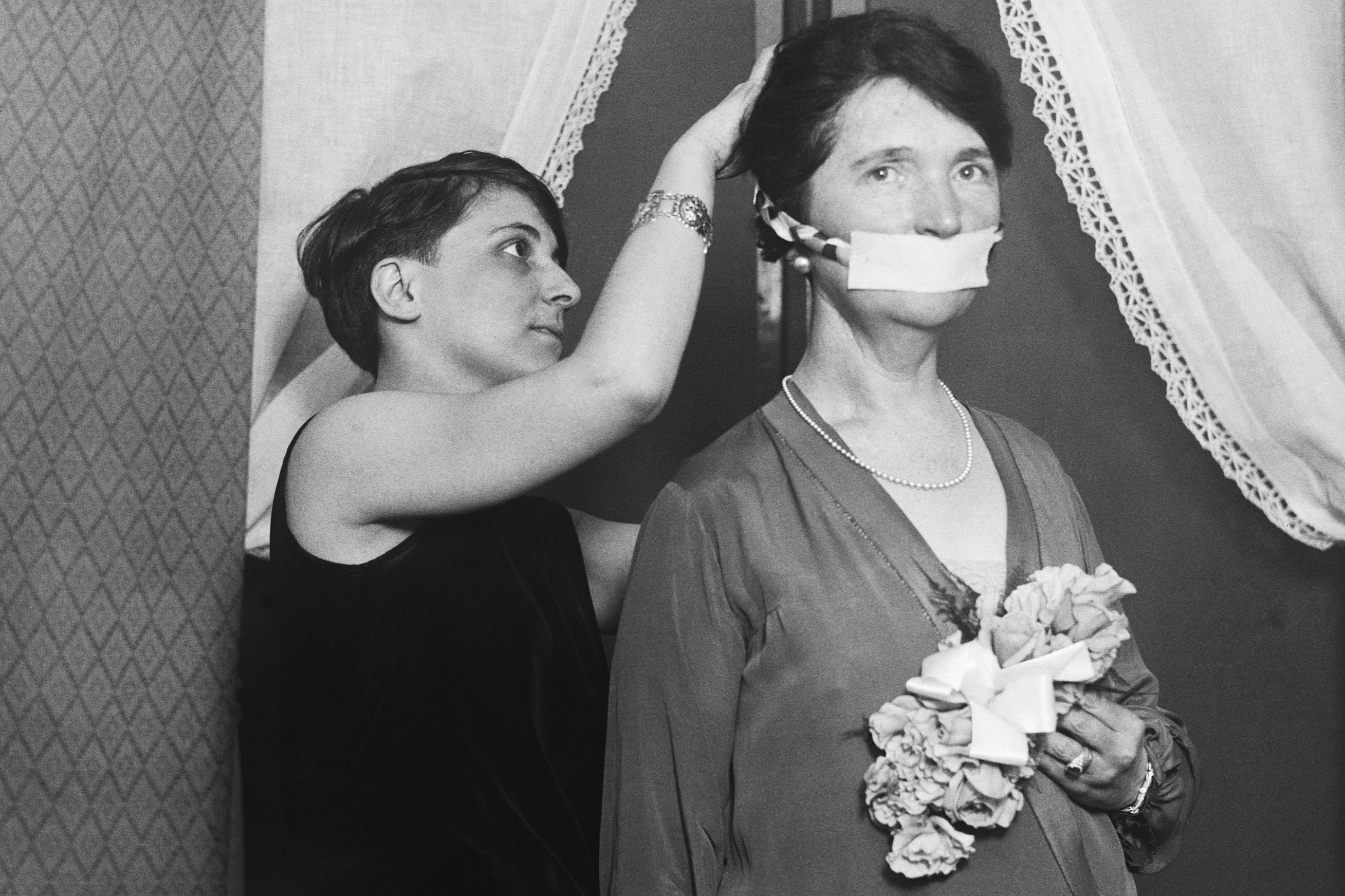 17 April 1929: Birth control advocate Margaret Sanger having her mouth covered in protest against not being allowed to talk about birth control in Boston, Massachusetts, in the United States. (Photograph by Bettmann/Contributor)