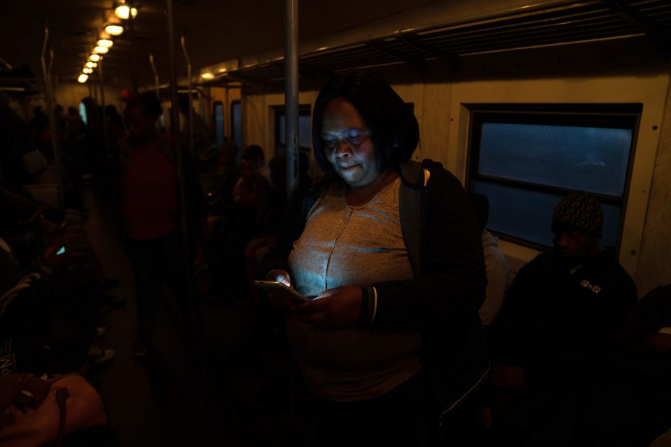 13 August 2019: Phindile Sithole is one of a group of commuters who have taken it upon themselves to cover up broken train windows with plastic as a short-term solution against the elements.