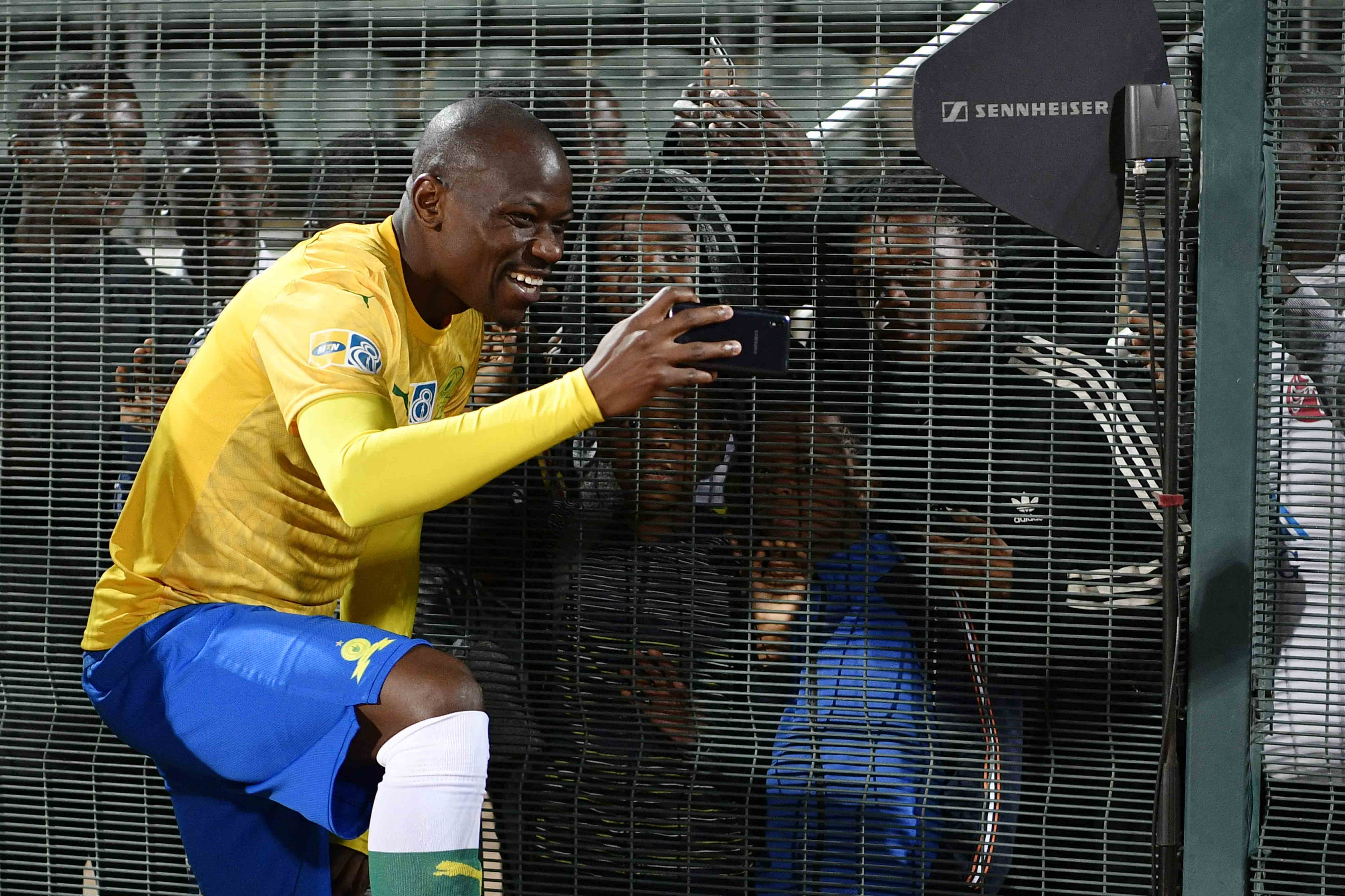 17 August 2019: Fans who usually watch games on SABC Sport missed seeing Mamelodi Sundowns' Hlompho Kekana posing with spectators at the MTN8 quarterfinal match between Sundowns and Bloemfontein Celtic. (Photograph by Lefty Shivambu/Gallo Images)