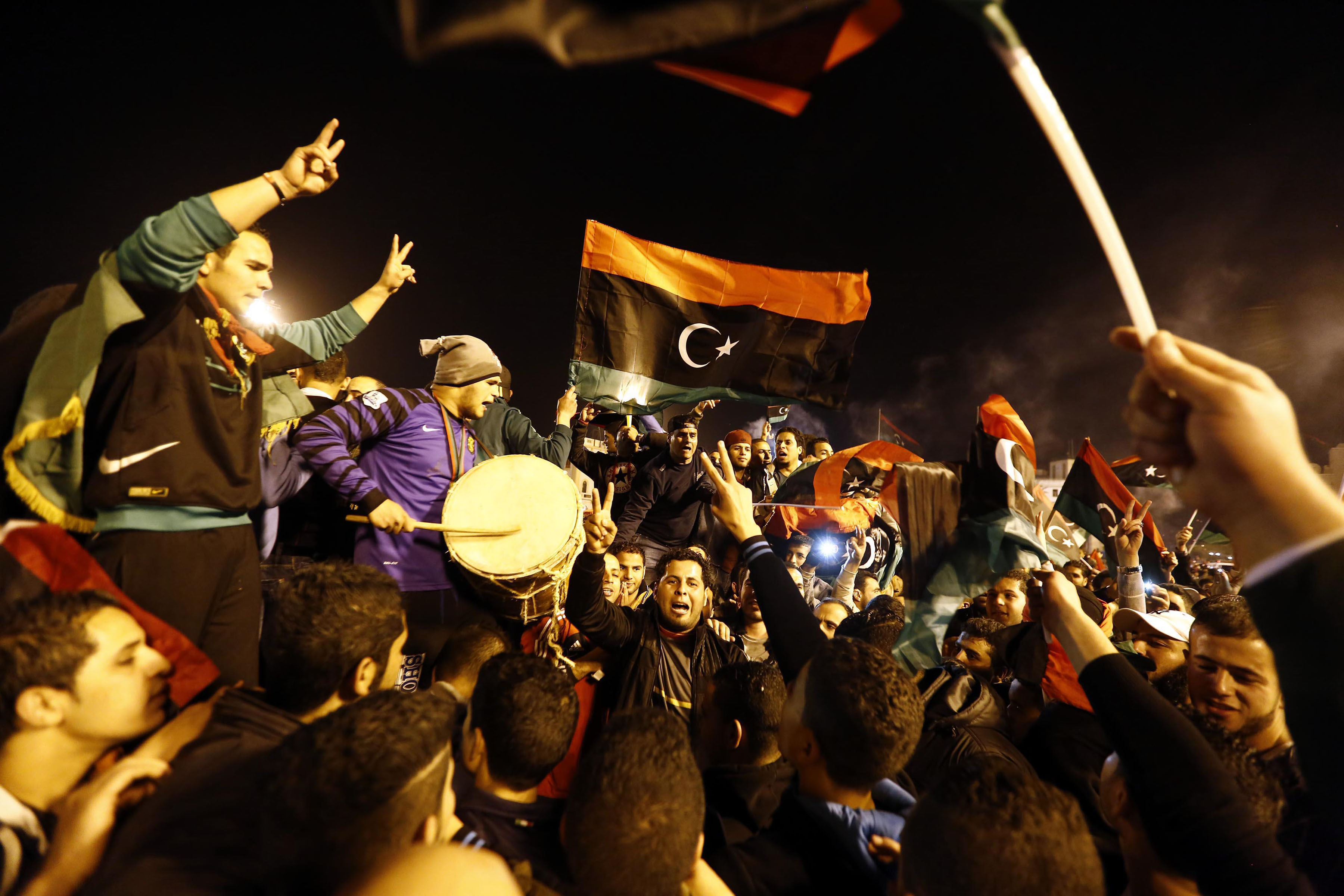 29 January 2014: Libyan football fans celebrate in Martyrs' Square after their national team defeated Zimbabwe in the African Nations Championship semi-final football match in Tripoli, Libya. (Photo by Hazem Turkia/Anadolu Agency/Getty Images)