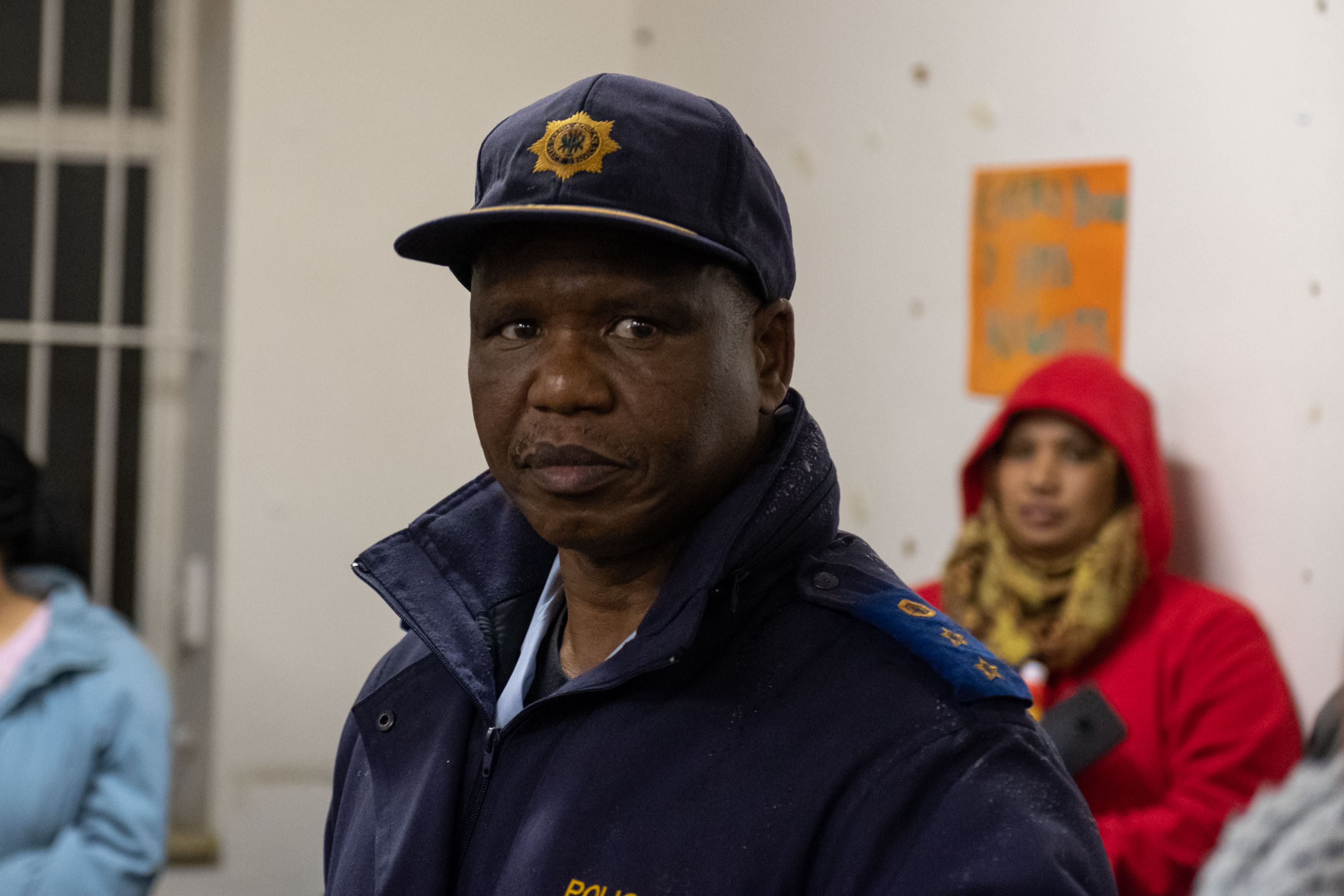 30 July 2019: Colonel Ntezo, the station commander at the Woodstock Police Station, came out to listen to the complaints of the residents but did not offer any direct answers to their questions about the reasons for the raid.