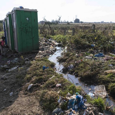7 May 2019: Dirty water streams past a toilet in Kliptown, which is strewn with rubbish.
