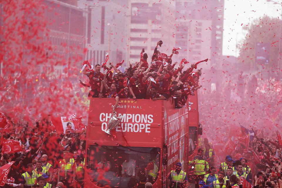 2 June 2019: Liverpool's squad atop a parade bus during their victory procession through the city of Liverpool with the UEFA Champions League trophy that they won by beating Tottenham Hotspur. (Photograph by Nigel Roddis/Getty Images)